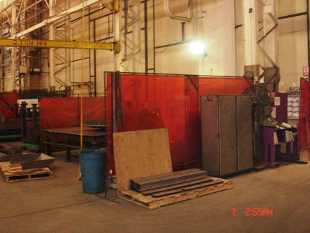 Welding screens on factory floor